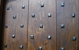 a close up photo of a cross boarded traditional door