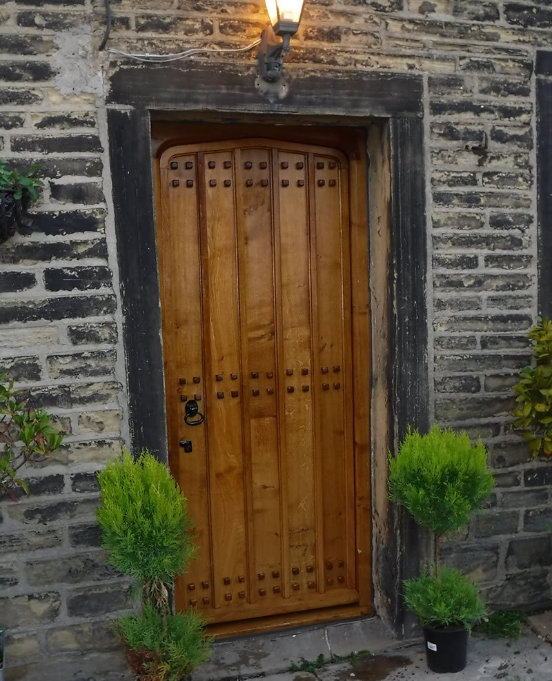 completed wooden door with studs in halifax