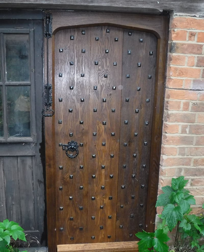 new wooden door on a converted stable