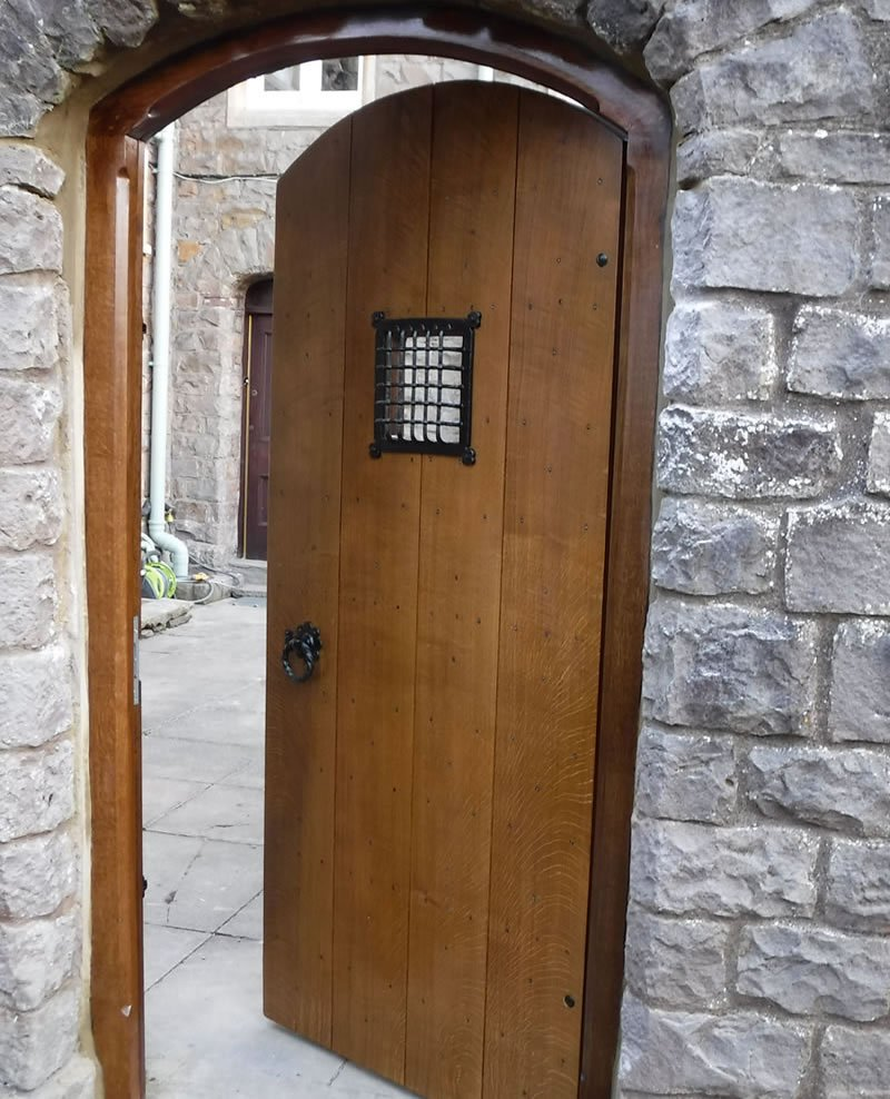 open garden door with a viewing panel at a vicarage in wales
