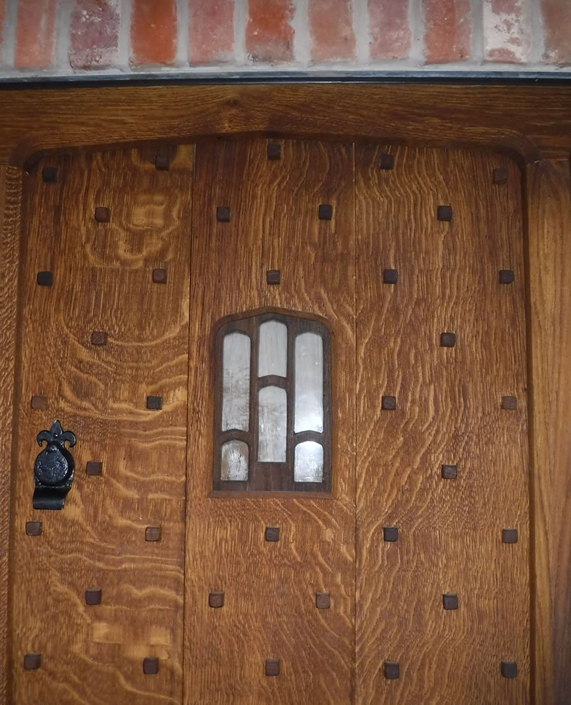 hand crafted english oak door with glass squint