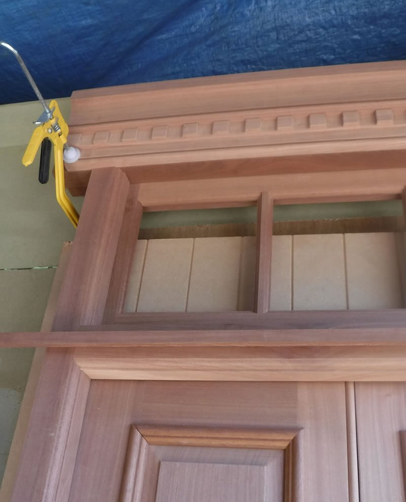 hand crafted door with glass panels