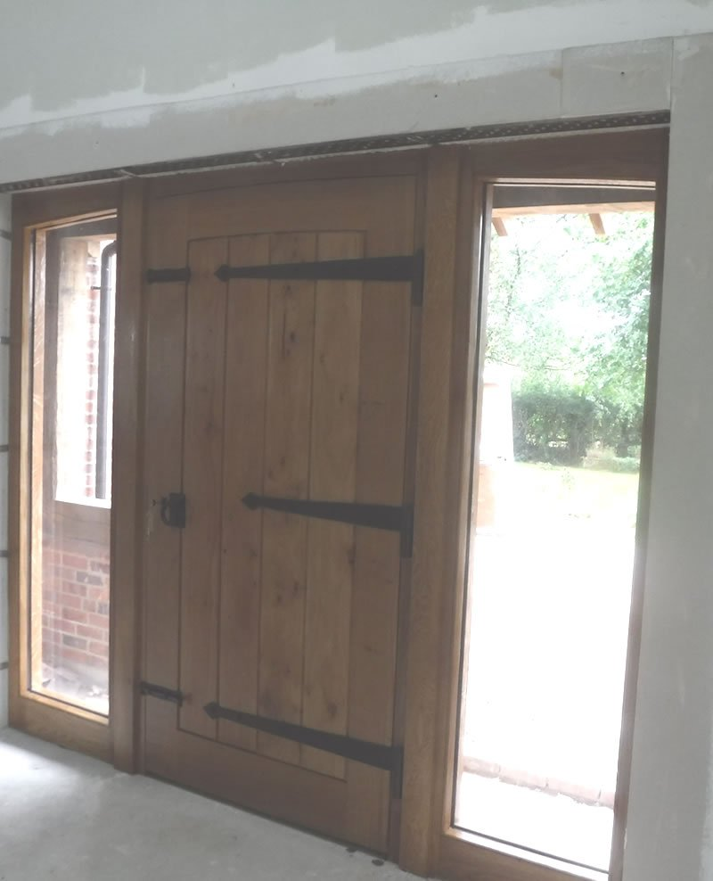 showing oak door from the inside of the farmhouse